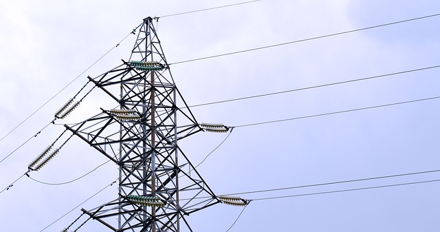 Transmission Line with Blue Sky and Clouds